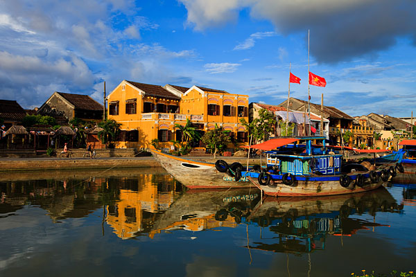 A view of the colourful Old Town and sight-seeing boats on the Thu Bon River, located in the UNESCO World Heritage Site of Hoi An.